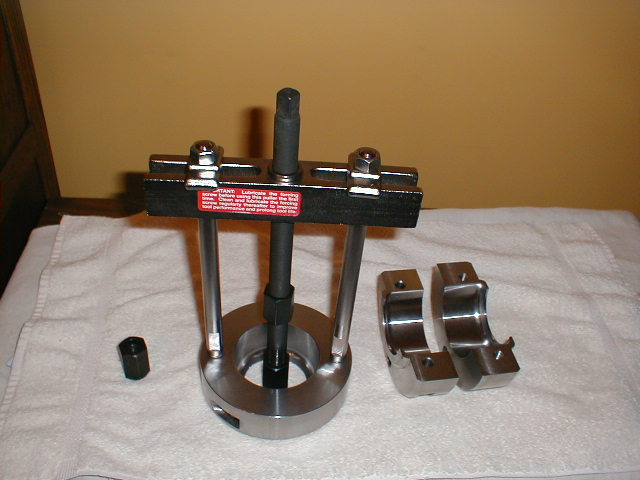 wheel bearing puller. split ring bolted together complete assembly wheel bearing puller